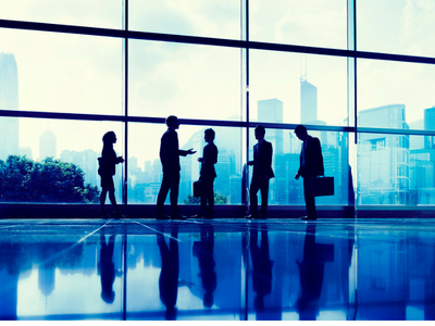 image of people meeting in a glass-wall building