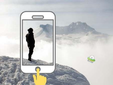 スマホを縦位置で撮影するイラストと山を眺める人