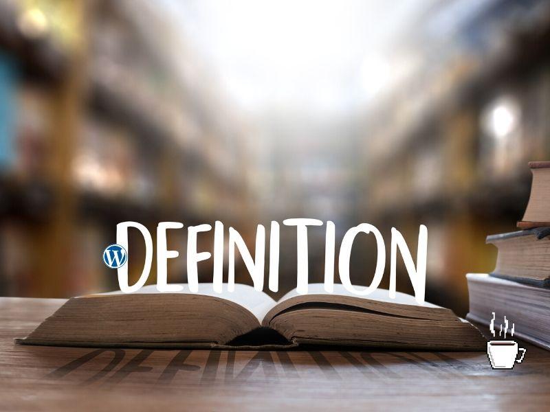 辞書とワードプレスのロゴとコーヒーカップ
